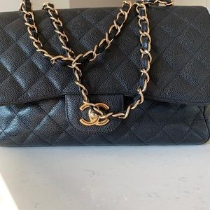 Chanel Flap Maxi handbag in excellent condition